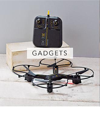 A drone with remote control unit. Gadgets. Shop now.