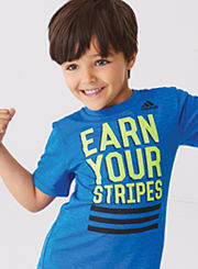 A boy wearing a blue and green ?Earn Your Stripes? graphic T-shirt. Shop boys' 4-7.