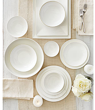 An assortment of white table settings. Shop dining & entertaining.