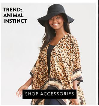 A brown croco leather handbag, a brown croco leather tote & a brown croco leather wallet. Trend Animal Instinct. Shop accessories.