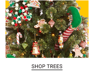 A fully decorated Christmas tree. Shop trees.