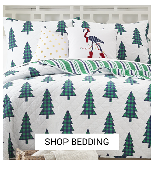 A bed made with a white & green Christmas tree patterned print comforter & matching pillows. Shop bedding.
