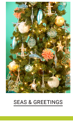 A Christmas tree decorated with nautical themed ornaments. Shop Seas & Greetings.