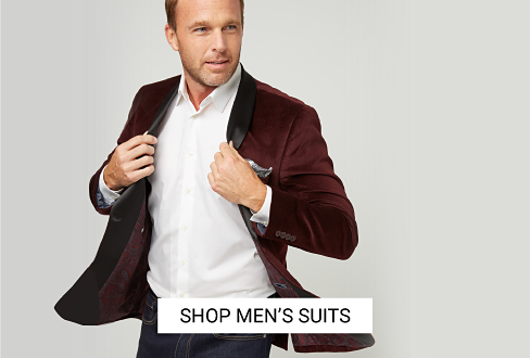 A man wearing a black suit & white dress shirt. Shop men's suits.