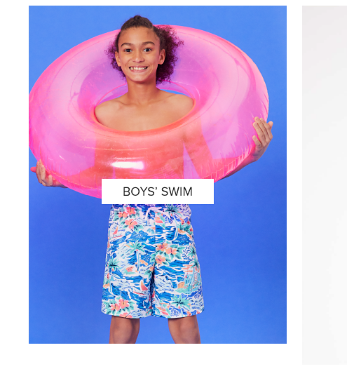 A little boy in brightly colored swim trunks
