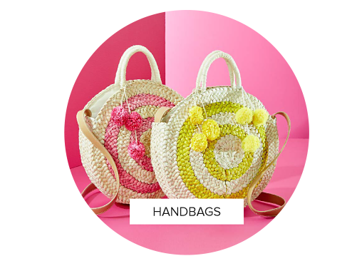 A straw beach handbag with yellow designs next to a straw beach handbag with pink designs. Shop handbags.