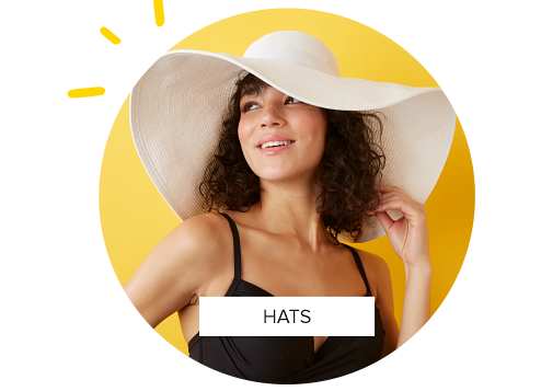 A woman in a black swimsuit and a white hat with a large rim. Shop hats