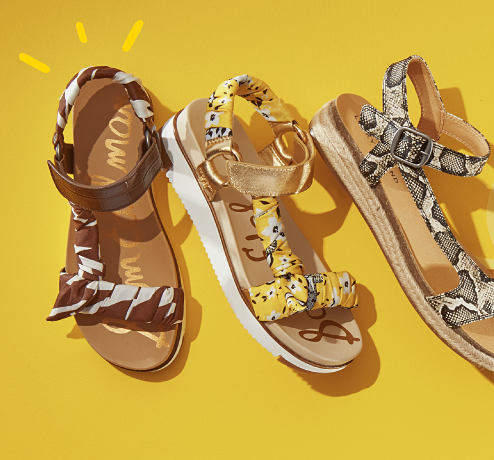 An assortment of women's sandals in a variety of colors and patterns. Follow the sun. These sandals are going places.