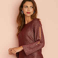 A woman wearing a burgundy long sleeved top. Shop tops.