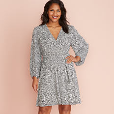 A woman wearing a gray long sleeved dress. Shop women's plus.