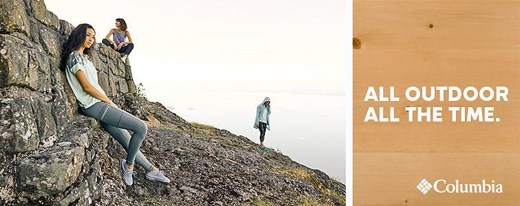 Women on a hillside in Columbia apparel.