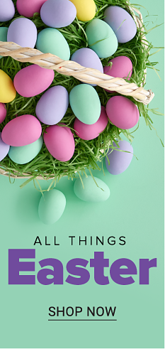 An easter basket filled with an assortment of colorful eggs on a bed of grass. Easter shop. Shop now