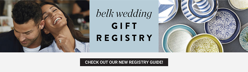 A man wearing a black jacket & white T-shirt sitting next to a woman wearing a light blue blosue. An assortment of plates & bowls in a variety of colors & styles. Belk Wedding Gift Registry. Check out our new registry guide.