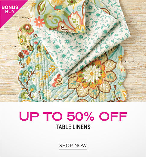 A floral place setting and a reversible floral cloth napkin to match. Bonus buy. Up to 50% off table linens. Shop now.