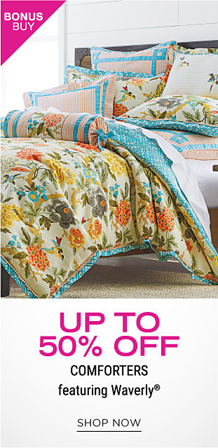 A bed with a colorful, floral comforter and pillows to match. Up to 50% off comforters featuring Waverly. Shop now.