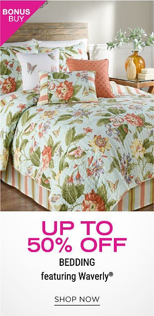 A bed with a colorful floral comforter and matching pillows. Bonus buy. Up to 50% off bedding featuring Waverly. Shop now.