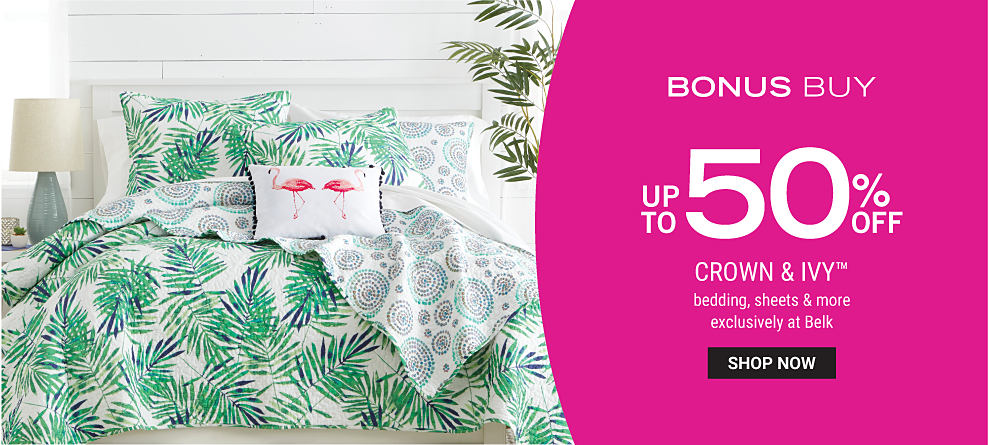 A bed with a reversible white and green palm print comforter and pillows to match. Bonus buy. Up to 50% off Crown and Ivy bedding, sheets and more, exclusively at Belk. Shop now.