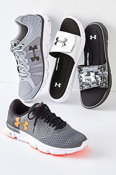 An assortment of men's Under Armour athletic shoes. Shop shoes.