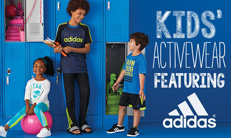 A group of kids standing in front of lockers at school in activewear styles from adidas.