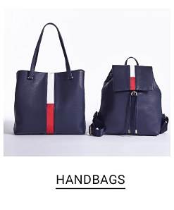 A navy tote bag and back pack with red and white Tommy Hilfiger logo details. Shop handbags.