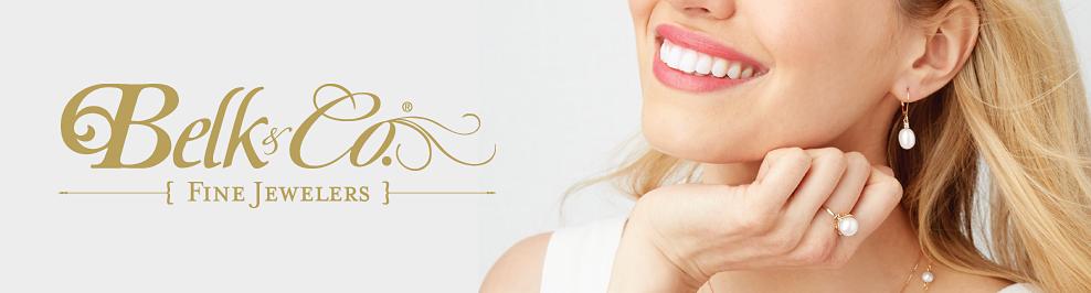 A woman wearing pearl earrings & a pearl ring. Belk & Co. Fine Jewelers.