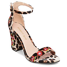 A leopard print heel with rose detail. Shop heels.