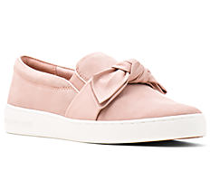 A peach fashion sneaker with bow detail. Shop sneakers.