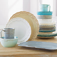 An assortment of dishes, bowls & mugs in a variety of colors.