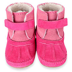 Plush pink baby booties with white lining & velcro straps