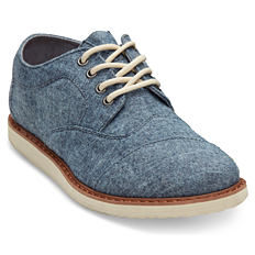 A denim blue boys casual shoe with white laces.