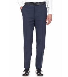 A man wearing a white button-front shirt & black pants. Shop pants.