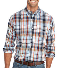 A man wearing a multi-colored plaid button-front shirt & blue jeans. Shop casual shirts.