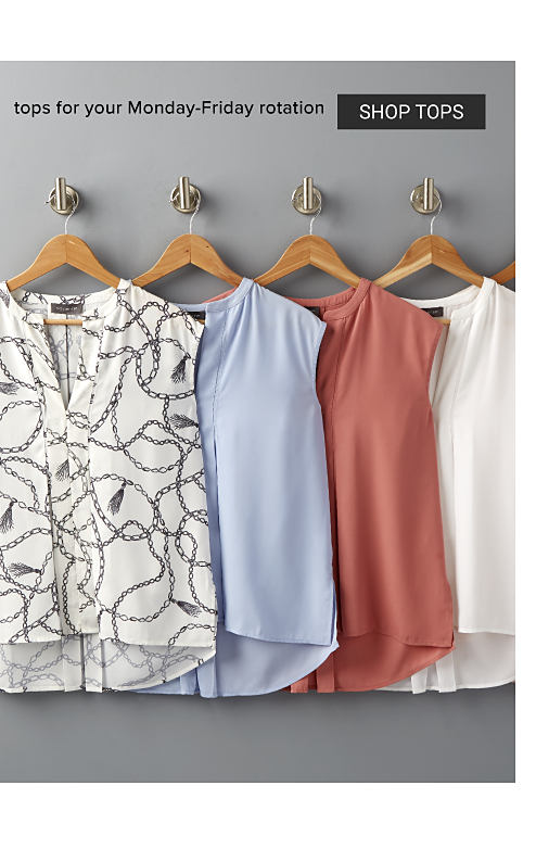 An assortment of sleeveless tops in a variety of colors & prints hanging on wooden hangers. Tops for your Monday through Friday rotation. Shop tops.