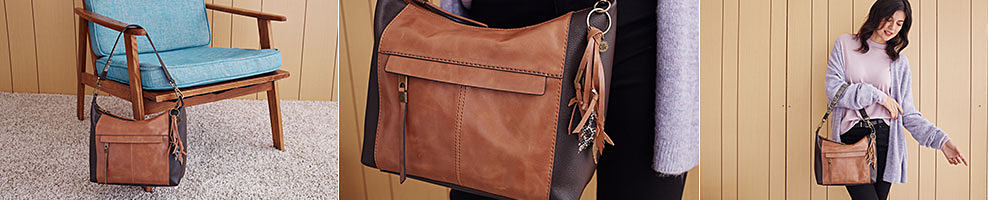 A brown leather tote hanging off a blue chair. A woman wearing a purple open front sweater over a gray top & blue jeans. carrying a brown leather tote. The Sak. Hit refresh this season with soft leather neautrals & chic crafted details.