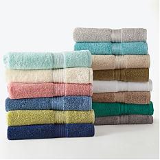 2 stacks of folded towels. Shop bath.