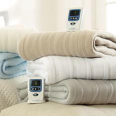 A stack of folded blankets. Shop blankets.