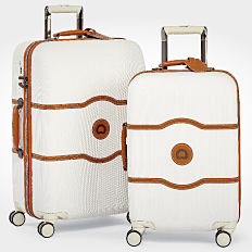 2 white and tan rolling suitcases. Shop luggage.
