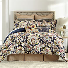 a bed with a printed comforter and pillows to match. Shop bed & bath.