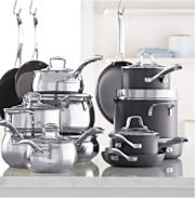 A stack of mirrored pots & pans next to a stack of non-stick pots & pans. Shop cookware sets.
