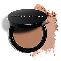 A compact of Bobbi Brown blush with a matching blush smudge. Shop cheeks.