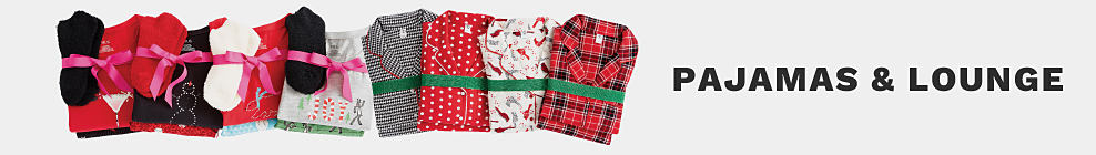 An assortment of folded pajama sets wrapped with ribbons. Pajamas & Loungewear
