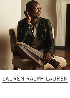 A woman in a white blouse and a leather moto jacket with gray and pink plaid wide leg pants and black heels. Lauren Ralph Lauren.