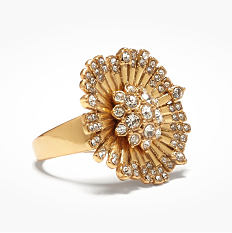 A gold tone floral style ring. Shop rings.