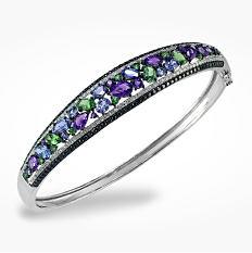 A diamond & silver bracelet. Shop bracelets.