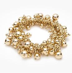 A gold tone & faux pearl bracelet. Shop bracelets.