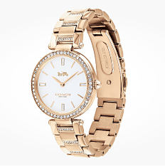 A gold tone watch. Shop watches.