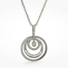 A silver tone pendant necklace. Shop necklaces.