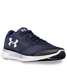 A navy men's athletic shoe with a white Under Armour logo on the side. Shop shoes.