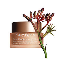 A small jar of Clarins skin cream. Shop day creams.