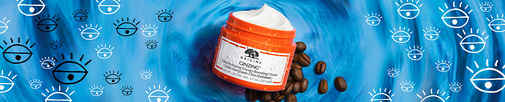 An orange container of Origins product on a blue patterned background.